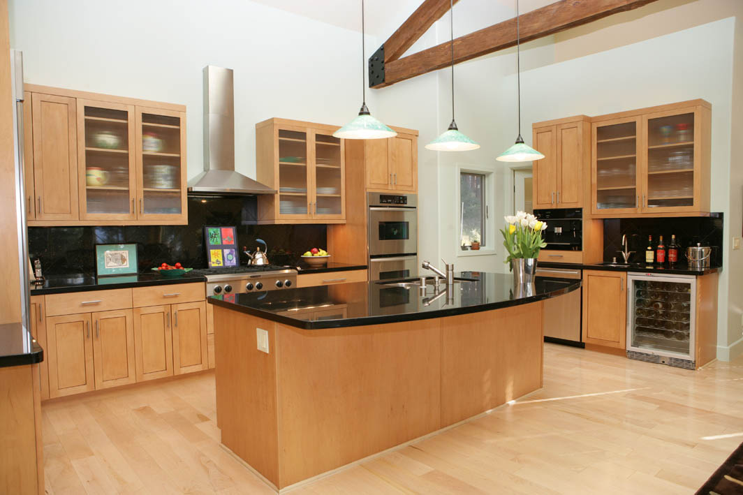 Kitchen with dark cabinets and light granite